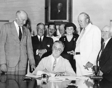 FDR-signing-the-Social-Security-Act