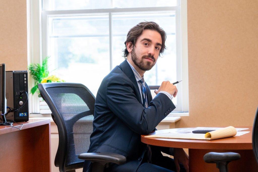 adam sclafani at his desk