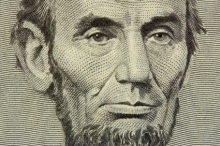 Abraham Lincoln's face on the five dollar bill