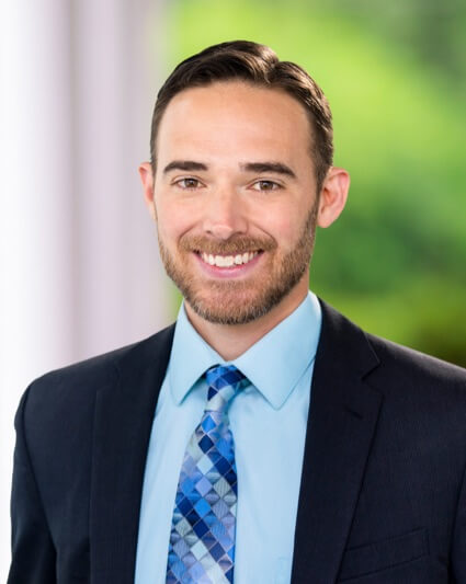 A professional headshot of Stephen Elliker